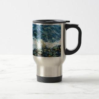 Rocky shoreline travel mug
