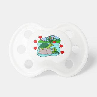 Rodeado por amor de la tortuga chupetes para bebés