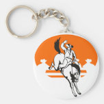 Rodeo cowboy riding a bucking bronco keychains