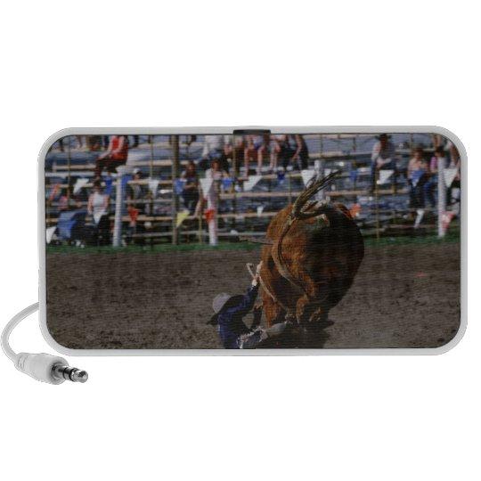 Rodeo rider falling from bull portable speaker