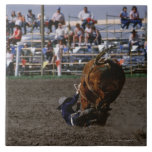 Rodeo rider falling from bull tiles