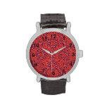 Rojo abstracto del modelo reloj de mano