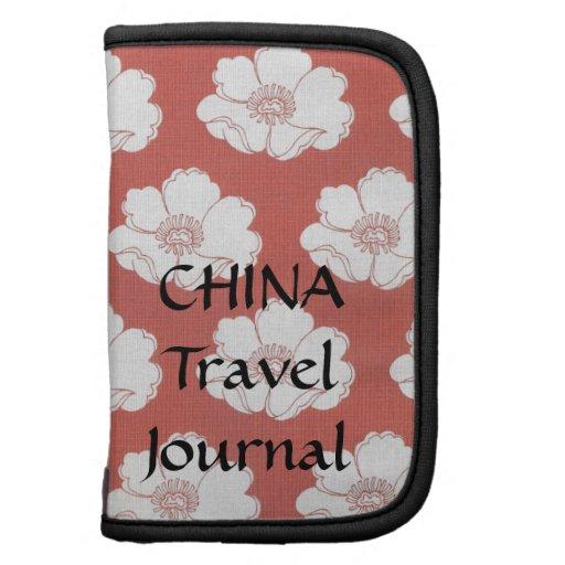 Rojo con la caja de encargo del diario del viaje d planificadores
