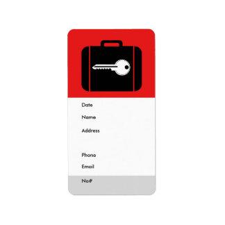 Rojo de la etiqueta del equipaje etiquetas de dirección