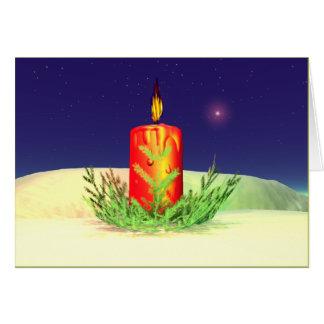 Rojo de la noche de la vela del navidad felicitacion