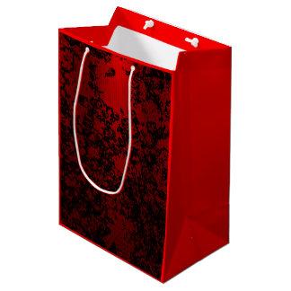Rojo de rubíes en elegante vibrante floral negro bolsa de regalo mediana