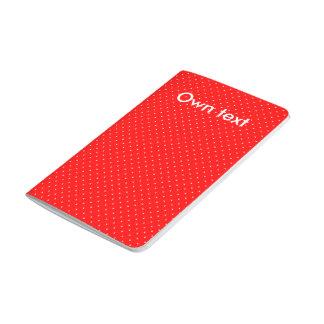 Rojo del diario del bolsillo con los puntos cuadernos grapados