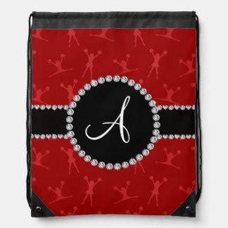 Rojo del monograma que anima el círculo negro mochila