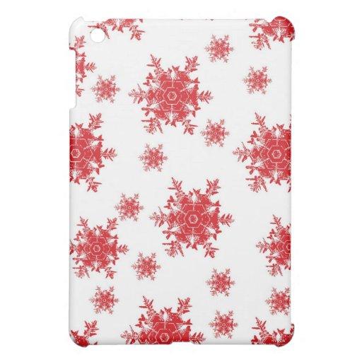 Rojo en el diseño blanco del copo de nieve