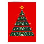 Rojo estacional de la tarjeta del árbol de navidad