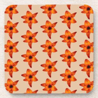 Rojo - flores anaranjadas del lirio, en color del  posavaso