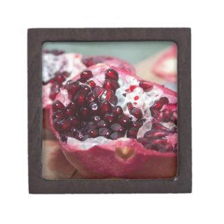 Rojo macro de la semilla de la foto de la fruta de caja de joyas de calidad