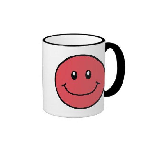Rojo sonriente 0001 de la taza de la cara