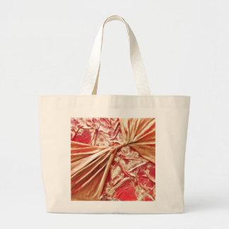 Rojo torcido y oro bolsas lienzo
