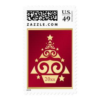 Rojo y franqueo del árbol de navidad del oro