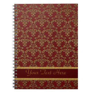Rojo y modelo del damasco del oro libro de apuntes