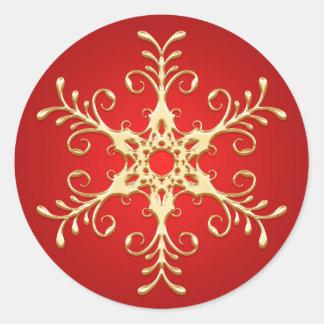 Rojo y pegatina del copo de nieve del oro