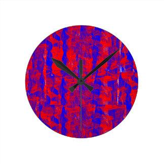 Rojos y azules del reloj de pared cerca: da'vy