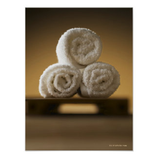 rolled hand towels in a stack poster