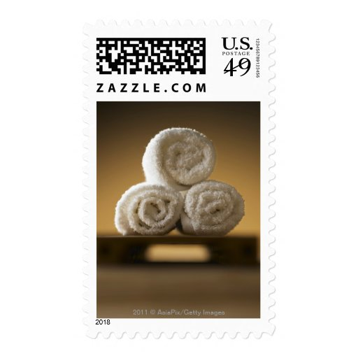 rolled hand towels in a stack stamps