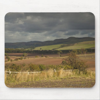Rolling Hills And Mountains Under A Cloudy Sky Mouse Pad