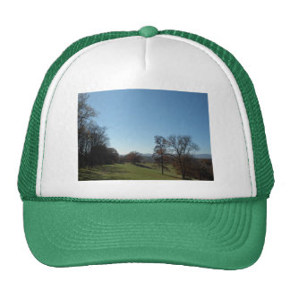 Rolling meadow and trees trucker hat