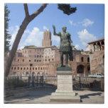 Roman emperor bronze statue at forum tile