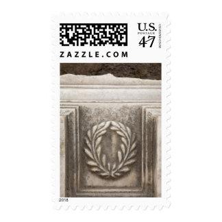 roman forum, laurel design on marble stone block postage