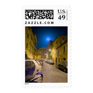 Roman neighborhood street at night postage stamp