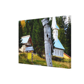 Romania, Traditional carving in village centre Canvas Print