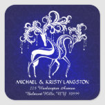 """Romantic Christmas Reindeer Return Address Sticker<br><div class=""""desc"""">Personalized Holiday Christmas Return Address Label Stickers -- Festive stag and doe reindeer in joyful winter play, their beautiful antlers magically decorated with fancy swirls and dangle ornaments. Modern folk-art drawing on midnight blue damask background and vintage chalk-style lettering. Customize it with your name and return mailing address, or favorite...</div>"""