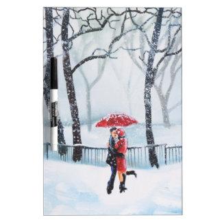 Romantic couple dancing in the snow red umbrella dry erase board
