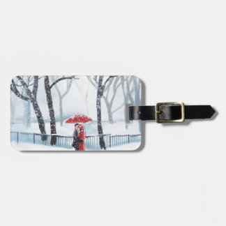 Romantic couple dancing in the snow red umbrella luggage tag