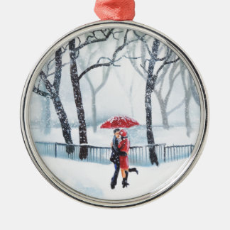 Romantic couple dancing in the snow red umbrella metal ornament
