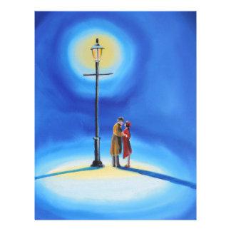 Romantic couple under a street lamp letterhead