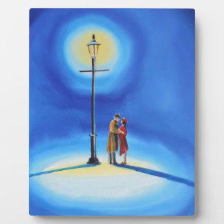 Romantic couple under a street lamp plaque
