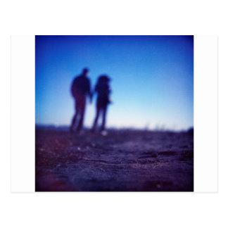 Romantic couple walking holding company hands on b
