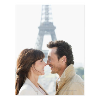 Romantic couple with the Eiffel Tower in the Postcards