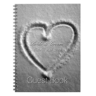 Romantic drawn heart in snow wedding guest book