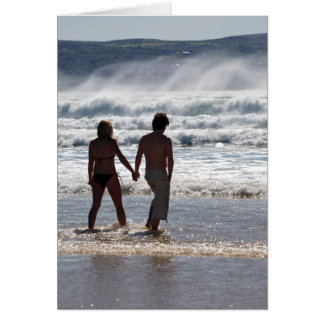 Romantic image of two people walking in the sea card