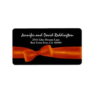 Romantic Orange Bow on Black Background Label