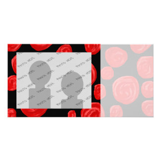 Romantic red roses on black background. card
