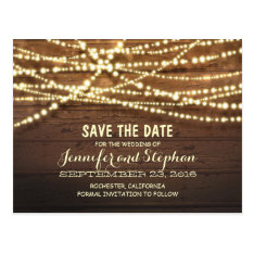 Romantic string lights rustic wood save the date postcard at Zazzle