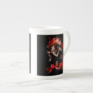 Romantic tango dancers on red fractal tea cup
