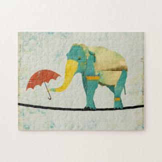 Rompecabezas agraciado de oro del elefante