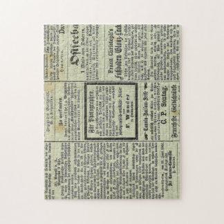 Rompecabezas alemán del periódico del vintage