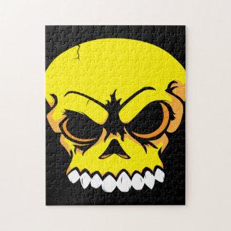 Rompecabezas amarillo del cráneo del vector