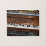 Rompecabezas antiguo del piano de jugador