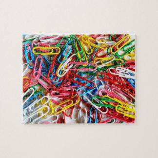 Rompecabezas colorido del material de oficina de l