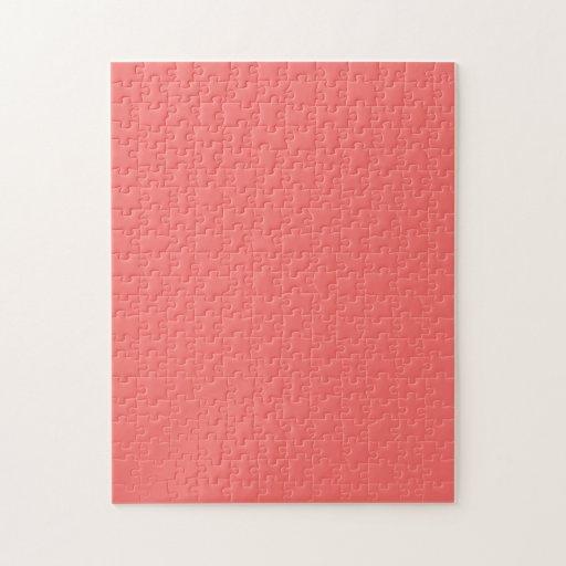 Rompecabezas con el fondo del rosa de color salmón